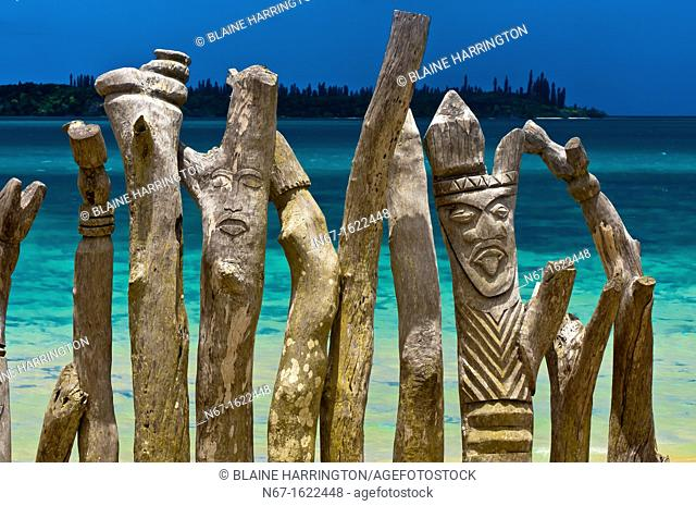 Carved posts totem poles, St  Maurice Bay, near Vao, Ile des Pins Isle of Pines, New Caledonia