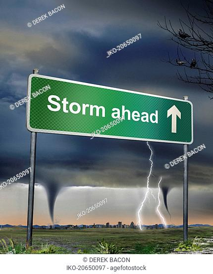Road sign warning of storm ahead