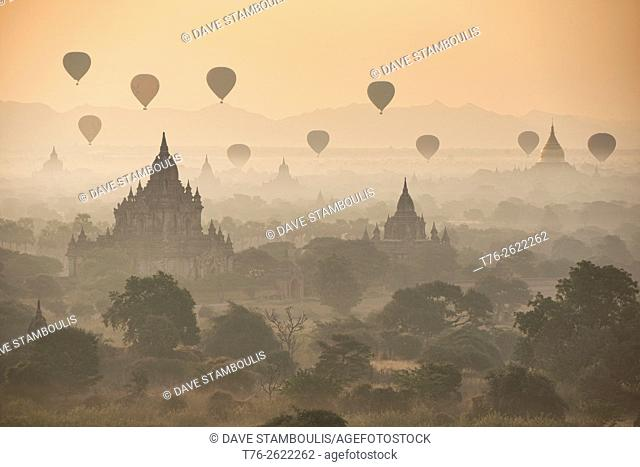 Balloons fly over the temples of Bagan, Myanmar at sunrise