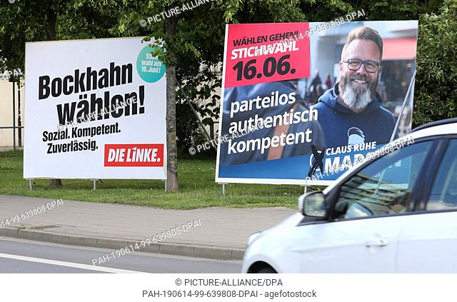 13 June 2019, Mecklenburg-Western Pomerania, Rostock: A car drives past election posters for Steffen Bockhahn (l-r), left-wing candidate, and Claus Ruhe Madsen