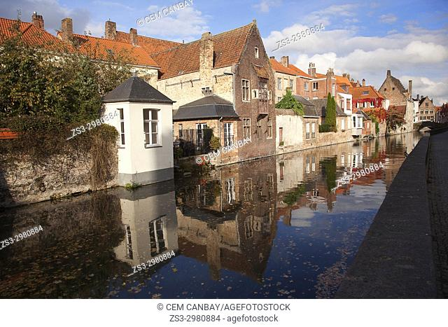 Traditionals houses and their reflections by the canal in the city center, Bruges, West Flanders, Belgium, Europe