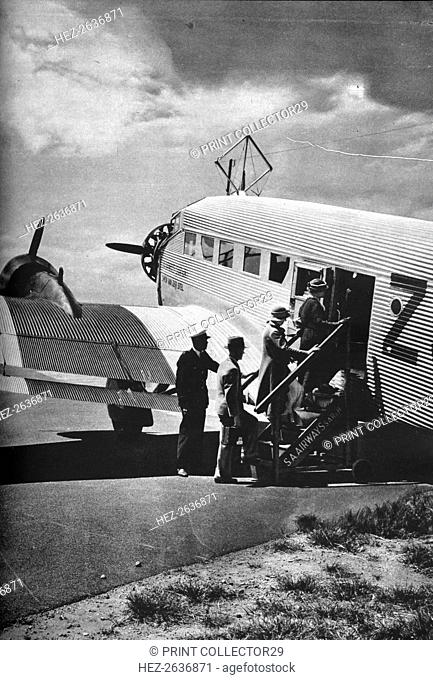 Passengers boarding one of the Junkers airliners of South African Airways, c1936 (c1937). Artist: Unknown