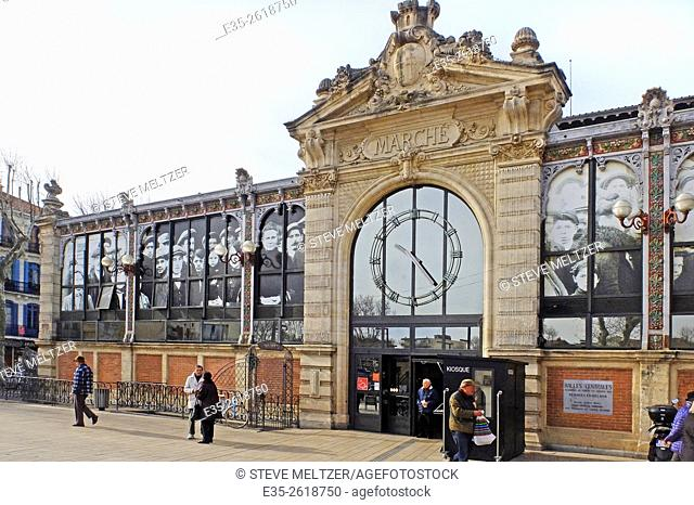 """The windows of the """"""""Halles de Narbonne"""""""" are decorated with photographic images of the people of 1900s Narbonne, France who built and shopped in this Baltard..."""