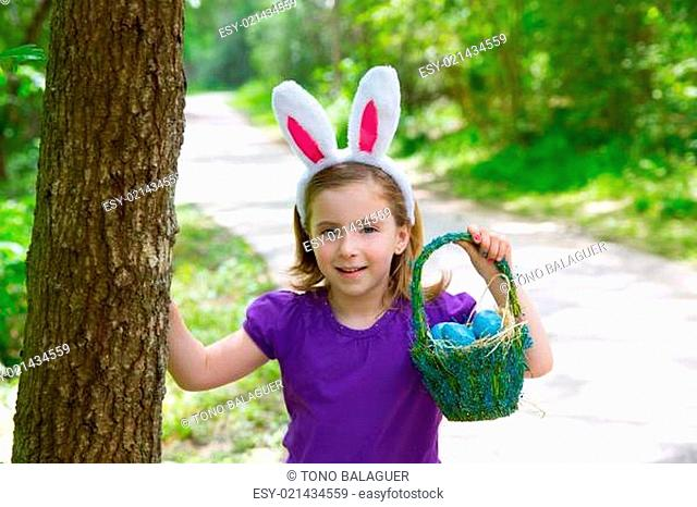 Easter girl with eggs basket and funny bunny ears