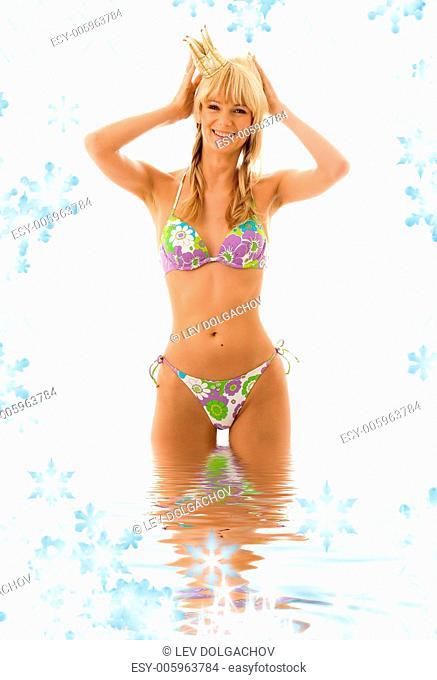pretty girl in princess crown and bikini in water