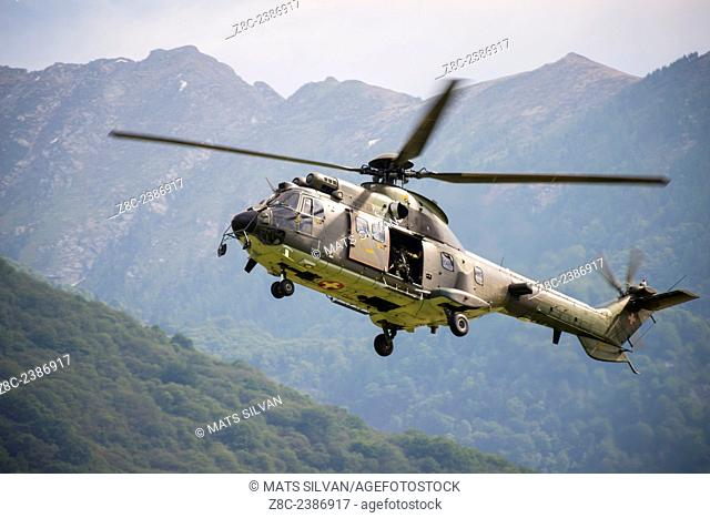 Military Helicopter flying and Swiss Alps in Ticino, Switzerland