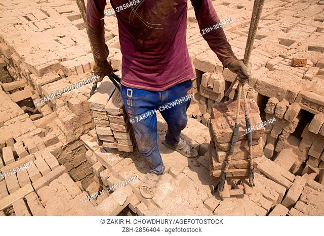 DHAKA, BANGLADESH - APRIL 29 : Workers working in bricksfield in Dhaka, Bangladesh on April 29, 2017. . About 11,000 brickfields are continuing in Bangladesh to...