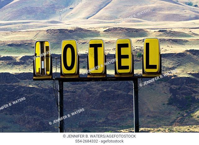 Broken old motel sign in Biggs Junction, Oregon, USA