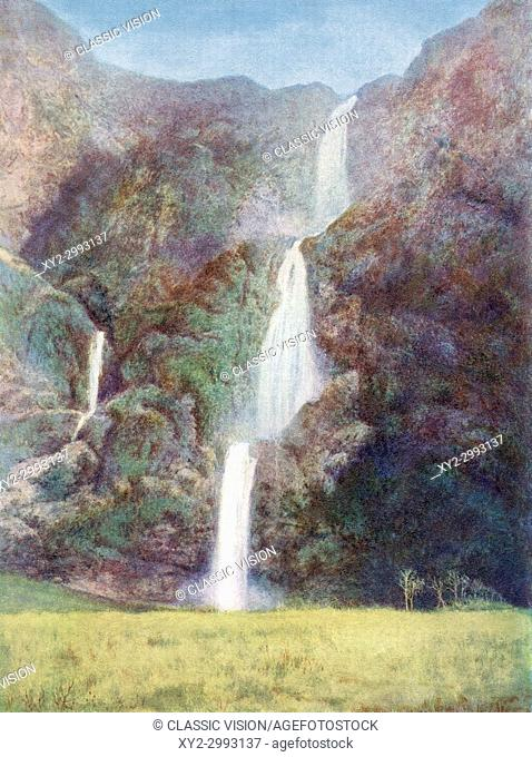 Sutherland Falls, near Milford Sound, South Island, New Zealand. From The Wonders of the World, published c. 1920