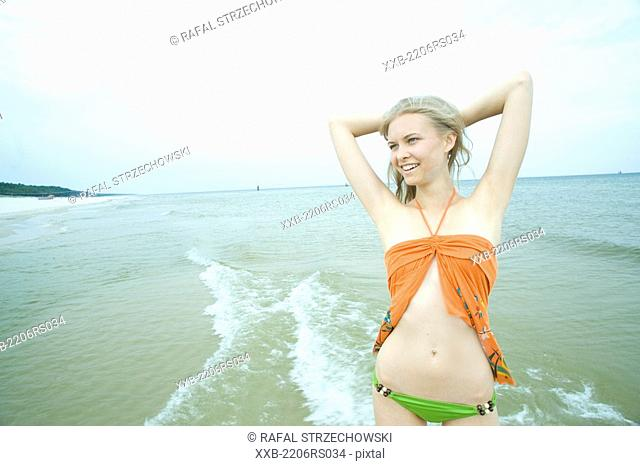 young woman playing in the sea