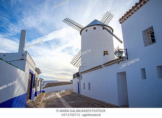 Street and windmill. Campo de Criptana, Ciudad Real province, Castilla La Mancha, Spain