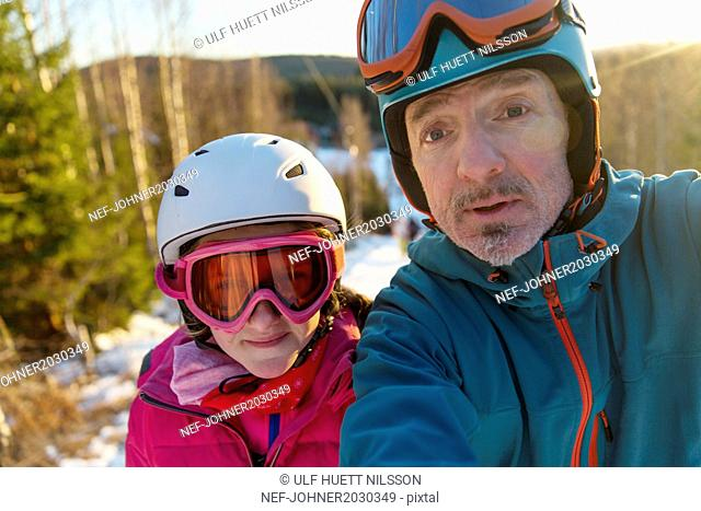 Man and daughter taking self portrait