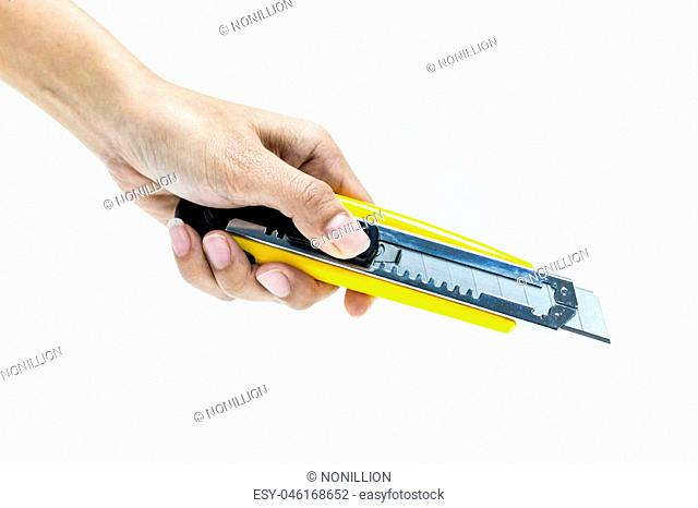 hand holding cutter, sharped knife