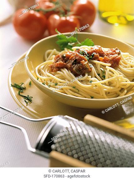 Spaghetti with tomato & vegetable sauce and parsley