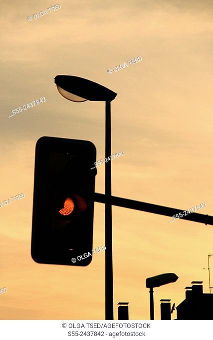 Traffic light on orange. Barcelona, Catalonia, Spain