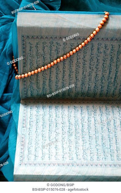 Veiled Kuran and prayer beads