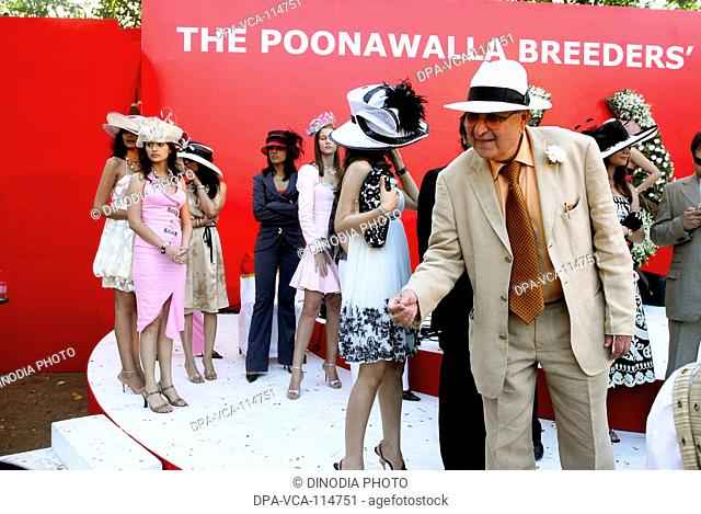 South Asian Poonawala breeders with fashion models at mahalaxmi racecourse ; Bombay  Mumbai  ;  Maharashtra ; India