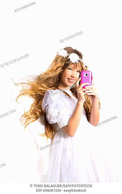 Angel blond girl taking picture mobile smartphone and feather wings on white byod to heaven