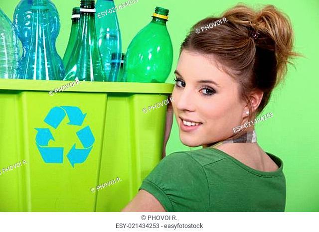 Young girl sorting plastic bottles