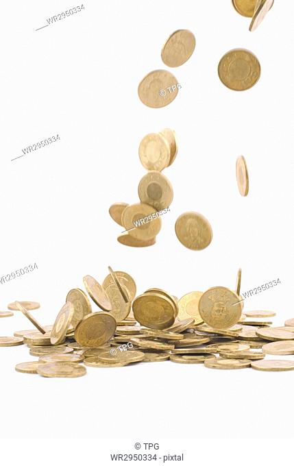earning money concept, falling golden coin, with white background. wealth concept