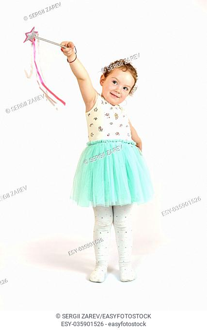 Fashion little girl in green dress, in catwalk model pose, stock photo. Image 01