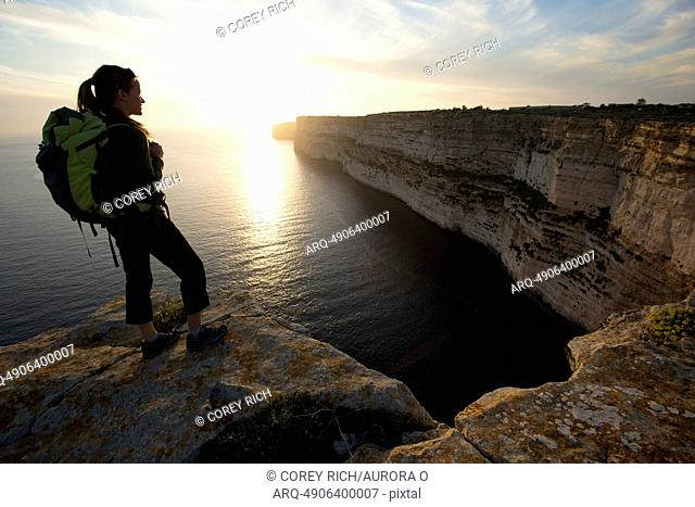A woman takes in the view while on a sport climbing trip in Malta
