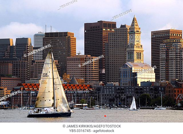 A Sailboat Passes in Front of the Custom House and the Boston Skyline