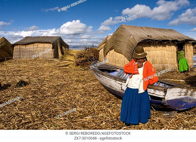 Uros Island, Lake Titicaca, peru, South America. These islands are built on a dense totora vegetation, which with the passage of time interweave their roots...