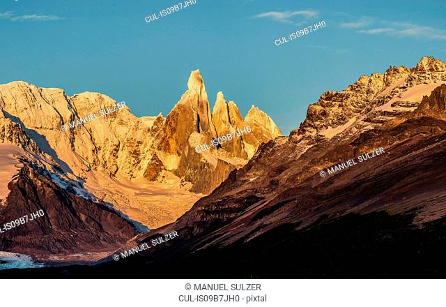 View of Cerro Torre mountain range against blue sky, Los Glaciares National Park, Patagonia, Argentina