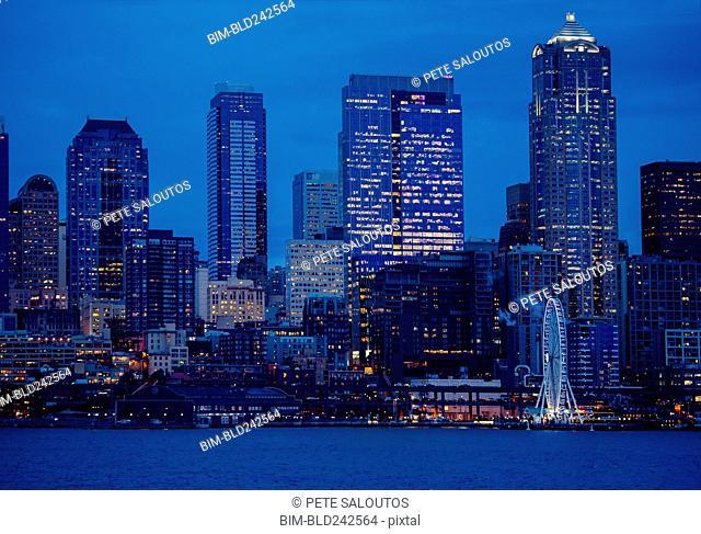 Illuminated city skyline at waterfront
