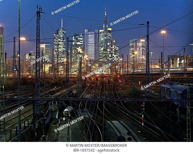 View of the main train station with a moving ICE train, behind the Commerzbank, Dresdner Bank, Skype, Frankfurt, Hesse, Germany, Europe