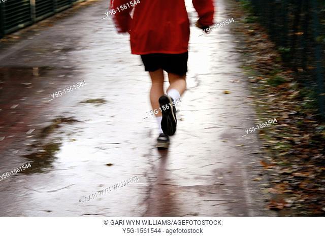 fast man runner on country lane