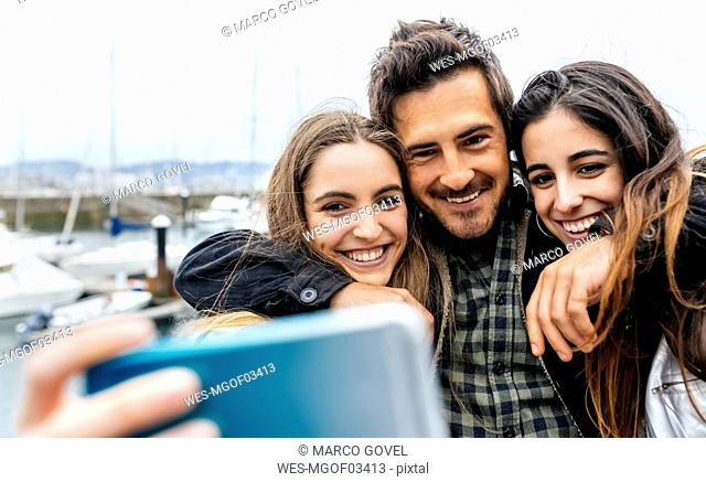 Three friends taking a selfie at the marina