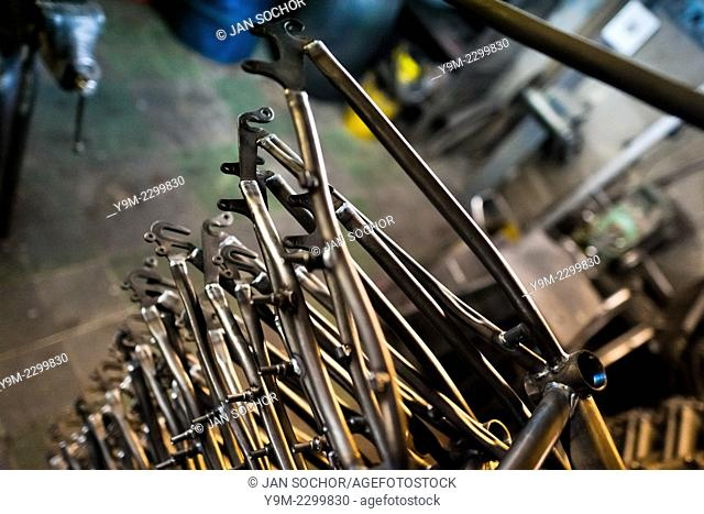 Recently welded bike frames are seen piled up in a small scale bicycle factory in Bogota, Colombia, 10 April 2013. Due to the strong