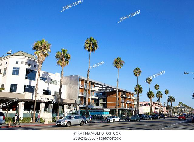 Restaurants, shops and pedestrains along palm tree-lined, trendy Ocean Avenue in Santa Monica, California, USA