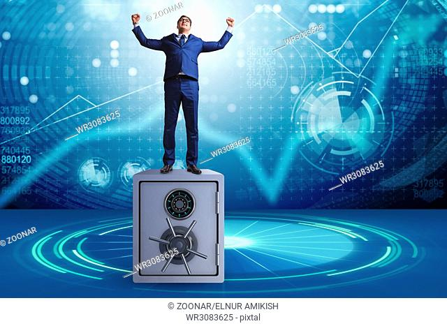 Businessman standing on top of safe