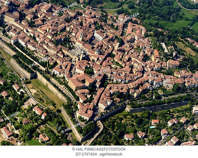 aerial shot, from a small plane, of south western side of city-walls ramparts and buildings in old high town of Bergamo, Lombardy , Italy