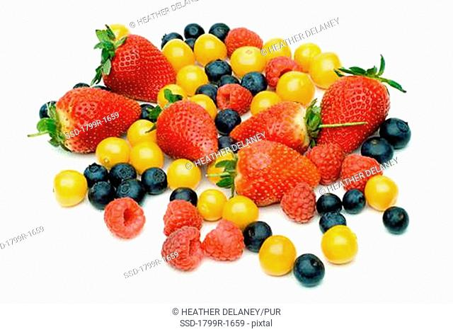 Close-up of strawberries and blueberries with gooseberries