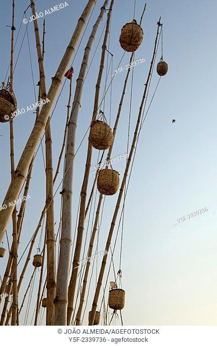 Baskets hanging in rods at Varanasi