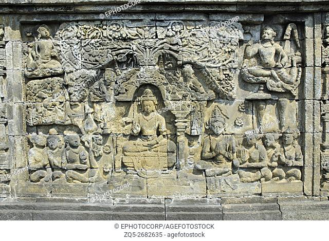 Indonesia-Java-Borobudur, 4th terrace/gallery western side. Bodhisattvas? seated in teaching attitude with devotees on either side