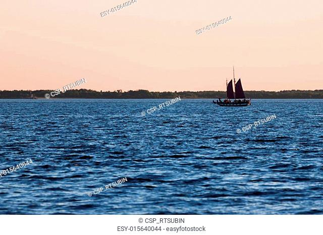Old sail ship silhouette in sunset