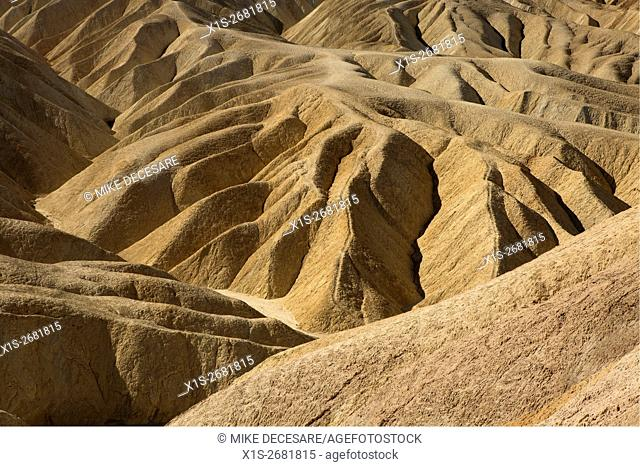 Ridges fan out in all directions to form steep lines in the sandstone mountains at Zabriskie Point in Death Valley
