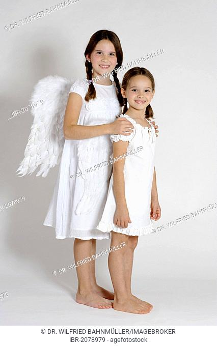 Two girls dressed up as Christmas angels, Christmas