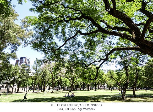 Argentina, Buenos Aires, Palermo, Plaza Alemania, park, green space, trees, lawn, skyline, boy, family, Hispanic, Argentinean Argentinian Argentine South...
