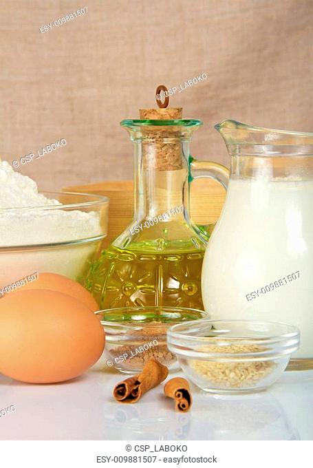 Jug with milk, sunflower oil, eggs and spices