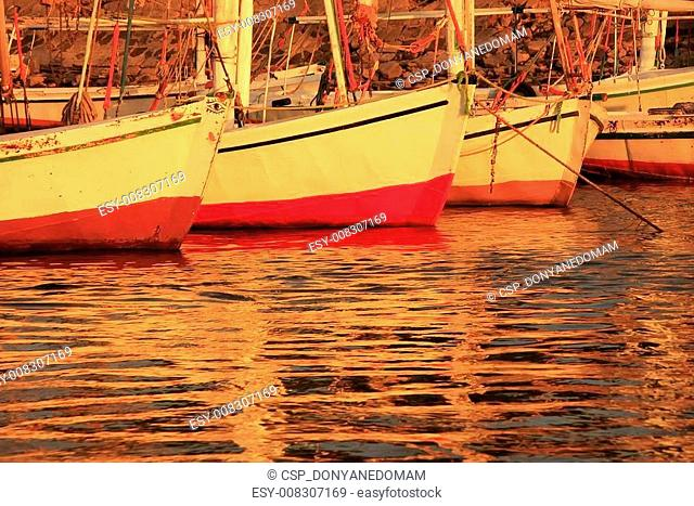 Felucca boats at the harbor at sunset, Luxor