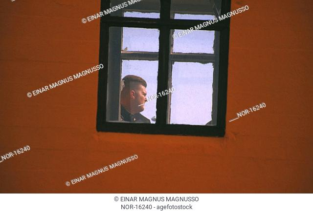 One man outide of a window
