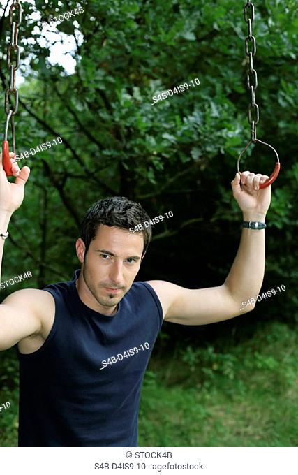 Man standing between rings