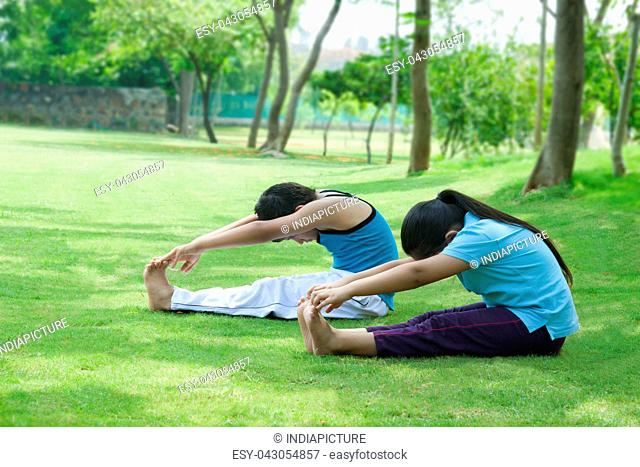 Children exercising in park