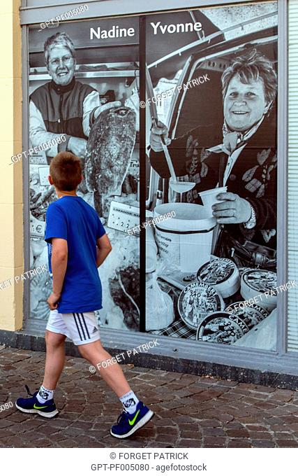 GIANT PHOTOS ON THE WINDOWS OF THE CLOSED SHOPS, RUGLART FESTIVAL, RUGLES (27), FRANCE